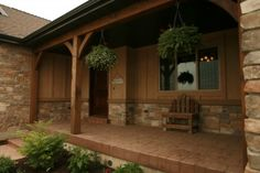 Stone combined with board and batten. Front Porch Pillars, Front Porch Posts, Front Porch Design, Porch Columns, Side Porch, Craftsman Style Exterior, Ranch Remodel, Colorado Homes, Traditional Exterior