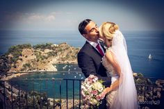 Bride&Groom passionate kiss over the Isola Bella in Taormina. get married in Sicily.