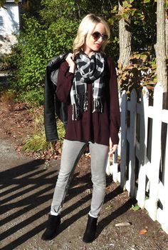 burgundy sweater and leather jacket
