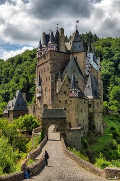 Medieval Castle Eltz. Burg Eltz is a medieval castle nestled in the hills above the Moselle River between Koblenz and Trier, Germany. It is still owned by a branch of the same family that lived there in the 12th century, 33 generations ago. The Rübenach and Rodendorf families' homes in the castle are open to the public, while the Kempenich branch of the family uses the other third of the castle. The Palace of Bürresheim (Schloss Bürresheim), the Castle of Eltz and...
