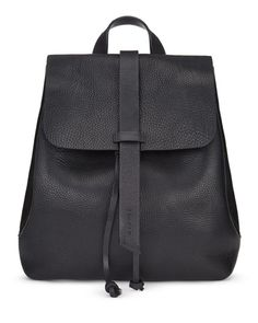 Handmade in a family-run factory in Portugal, the Blake Backpack is crafted from a supple leather that will age beautifully over time. With strong bridle leather for the adjustable straps and unlined for a natural finish, this piece is practical yet stylish. Other features include a leather drawstring closure, a press-stud closure and an interior purse pocket to keep belongings safe.