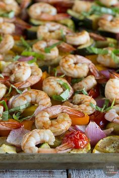 This dinner is a great way to use up the summer vegetables! Enjoy dinner tonight with this Sheet Pan Balsamic Shrimp and Summer Vegetables!
