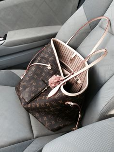 Louis Vuitton Neo Neverfull MM with pink flower bag charm from http://www.poppyhearts.com riding shot gun:-) while hubby in the back seat:-p