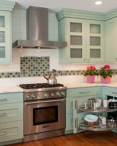 A simple, sweet country kitchen with mint cabinetry and an alternating pattern of green tiles along the white tile backsplash. Country Kitchen Backsplash, White Kitchen Counters, White Tile Backsplash, Kitchen Cabinetry, Kitchen Tiles, Kitchen Decor, Diy Kitchen, Backsplash Ideas, Inset Cabinets