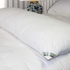 "Features:  -233 Thread count.  -100% Cotton cover.  -Solid weave.  Color: -White.  Cover Material: -100% Cotton. Dimensions:  Overall Height - Top to Bottom: -8"".  Overall Width - Side to Side: -54""."