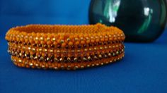 Orange copper and 14kt gold soft cuff/bangle by Ravenmood on Etsy, $12.00