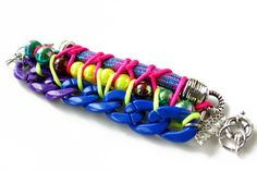 TheBuzz,  Neon chunky bracelet, knotted with ropes and chunky chains, sports chic, unique OOAK jewelry. $48,00, via Etsy.