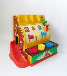 Fisher Price Cash Register- my great grandpa had one of these that im pretty sure my grandma, mom, and i all played with... i can't believe it was around that long!