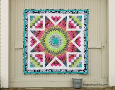 "Bella Vita Star Quilt Kit A Keepsake Quilting Exclusive! Brilliant colors come together to create this 75"" x 75"" twin-sized masterpiece of a quilt. Quilt kit includes pattern with Linda Fitch's piecing directions and RJR's Flaurie & Finch Blossom Batiks for the top and binding of this throw-sized quilt."