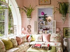 In my dream cottage in La Jolla or England-- such a pretty pink & green sunroom. Celerie Kemble.