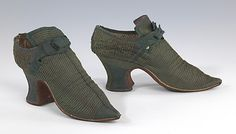 1700–1739, Shoes ornamented with multiple parallel rows of braid were a well-established fashion in the 17th century, and continued to enjoy stylishness in the early 18th century, when the preference was for matching braid and ground fabric as opposed to contrasting colors. This pair is a good example of that decorative style, and equally well illustrates the fashionable cut of the time, with pinched toe, high throat with small opening at the side and flared tongue, and sturdy high heel....