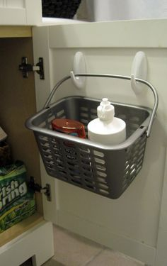 Smart. command hooks and a basket. Keeps eye solution, etc off the counter!