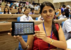 A student shows the Aakash tablet during a news conference in New Delhi, Oct. 5, 2011.