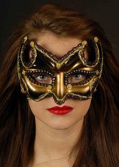 http://www.struts.co.uk/party-fancy-dress-shop/fancy-dress-sales/masked-ball-eye-masks/masquerade-eye-masks/black-and-gold-masquerade-eye-mask?cPath=134_240_241_140_611
