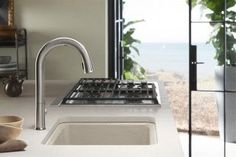 A softly curving Sensate Faucet pairs beautifully with the Riverby Sink. Kitchen Sink, Kitchen Taps, Seaside Kitchen, Sink In Island, Kitchen, Kitchen Sink Sizes, Kohler, Sink, Utility Sink