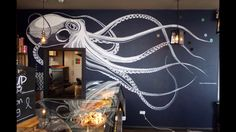 A black and white, striking and unique mural of a giant octopus in Cargo Restaurant on the Liverpool Waterfront, by Liverpool artist, Paul Curtis. Mural Cafe, Art Mural, Wall Murals, Octopus Wall Art, Octopus Bathroom, Deco Cool, Octopus Design, Modern Bungalow House, Bedroom Murals