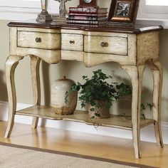 "Callands console table, $500, 30""W.  Cream weathered finish with brown wood top.   Wayfair.com"