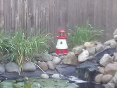 Lighthouse for my pond, made from terra cotta pots and solar light.