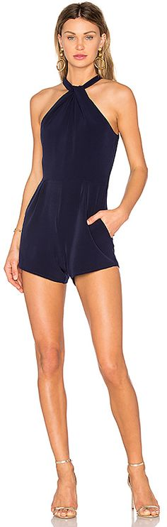 NBD Radley Romper in Navy. - size L (also in ) NBD Radley Romper in Navy. - size L (also in ) Always keep it classic in the Radley Romper by NBD. Deep navy sateen gives this singlet a sensual drape that's accentuated by a high neckline with a knotted detail. Tailored with pockets at the hips, it's the new essential for evening encounters.. Self: 94% poly 6% elastaneLining: 97% poly 3% elastane. Hand wash cold. Neckline keyhole with twist detail. Side seam pockets. Exposed back zipper c..