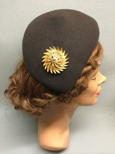 This desirable felt fascinator is the Lucille! It has an asymmetric shape and a sloping crown which forms a tear-drop shape. Trimmed with a beautiful vintage brooch. Colour: Brown #Fabhatrix #Edinburgh #Grassmarket #felt #fascinator #occasion