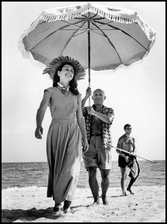 Robert Capa. FRANCE. Golfe-Juan. August, 1948. Pablo Picasso and Françoise Gilot.