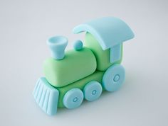 @Stephanie Krahenbuhl:  I love this fondant train.  Do you (here comes a BIG favor) think you could make a bunch of these for Tate's party?  I was thinking one on each cupcake or at least several engines and maybe a few of the simple train cars?