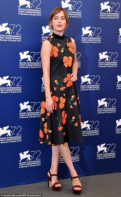 Blooming lovely! Dakota Johnson displayed her sartorial smarts in a black poppy dress at the photocall for A Bigger Splash at the Venice Film Festival in Italy on Sunday