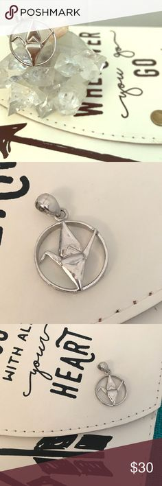 Origami Crane Pendant Sterling silver origami crane pendant. Great attention to detail. Pretty etching design on the ring around the crane. Beautiful piece. 😀 Jewelry Necklaces