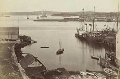 Sydney Harbour with MacBeth boat builder in foreground and Fort Denison in the distance in 1880.