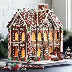 I make these every year with my grandchildren out of graham crackers and caned frosting. Get a  preformed cardboard house at a craft store cover windows with yellow cellophane cut a hil in back for light.