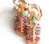 bohemian style greek sandals in pink yellow and green colors.
