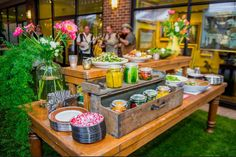 A abundance of pickled vegetables and salads set the tone at the entrance to the party