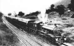 The Frontier Mail hauled by 'H' class #533 (4-6-0, North British, 1922) with the driver in a white uniform. From the Western Railway historical collection.