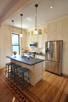 I like: Kitchen layout - Island with sink and barstool seating ... this has some similarities to my kitchen layout.  Like the paneling on the island and would consider detaching from the wall by the window like this one.  Would lose some counter and storage but I like the free standing!