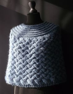Free knitting pattern for Chunky Cabled Capelet - Brian Smith's This cosy capelet / poncho has a simple basket weave cable pattern and a stocking stitch top with garter stitch bands. tba