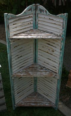 Reclaimed Shutter Shelves. Use adjoined shutters and wedge a piece of wood to create shelves