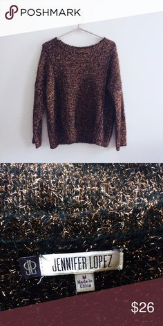 Jennifer Lopez Black and Copper Sparkle Sweater This gorgeous black and copper colored sweater by Jennifer Lopez is so soft and edgy! The sweater is absolutely beautiful and the copper adds pop of sparkle! The sweater is a bit shorter and is a size medium. Jennifer Lopez Sweaters