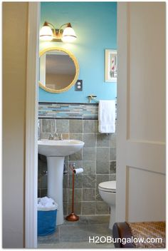 Beachy Coastal Bathroom Makeover that you can do on a budget.  Links to several projects I did to make this bathroom fun and original while on a budget!
