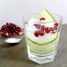 A festive and refreshing cocktail with cucumber-infused gin and pomegranate seeds