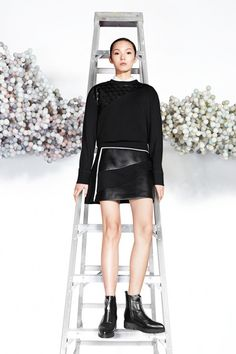 A black crew-neck pullover and a black leather mini skirt are a great outfit formula to have in your arsenal. Complement this look with black leather chelsea boots.   Shop this look on Lookastic: https://lookastic.com/women/looks/black-crew-neck-sweater-white-dress-shirt-black-mini-skirt/22967   — White Dress Shirt  — Black Crew-neck Sweater  — Black Leather Mini Skirt  — Black Leather Chelsea Boots