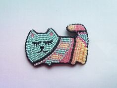 Beaded brooch cat with ornament by SomethingxEspecial on Etsy