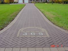 Decorative stamped asphalt allows you to customize your driveway to your home (landscaping a hill driveways)