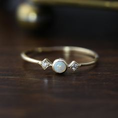 "Three stone opal ring is called ""Star and Moon Ring"", made in 100% recycled solid 14k gold Inspired by vintage art deco style ring, it is very light weight and comfortable on your finger. Opal is know"