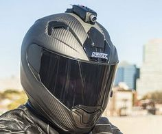 The most advanced helmet mounted accessory ever built, it comes in a sturdy waterproof housing and is equipped with everything from an accelerometer, a HD camera, Wi-Fi, and a GPS. Custom Motorcycle Helmets, Custom Helmets, Motorcycle Outfit, Motorcycle Accessories, Motorcycle Camera, Riding Gear, Riding Helmets, Dark Helmet, Helmet Camera
