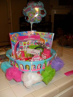 Got this idea from here and changed it up a little. Was really fun to put together and the little girl liked it. Actually added some more candy/headbands/lotion to it after this picture-- but coming from someone not crafty, it was fun to put together!! For a 6yr old girls birthday! My 6yr old help me put it together too! She loved the idea, also!