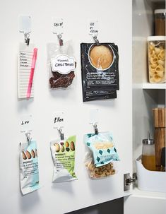 The pantry door can be kitchen storage space for lightweight items. Use white IKEA PLUTT self-adhesive plastic hooks and RIKTIG silver clips inside the door to hang nuts, dry sauce packs, and your grocery list.