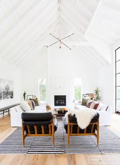 Bright boho living space with Icelandic sheepskins thrown effortlessly across vintage accent chairs.