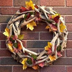 Add Fall leaves to a driftwood wreath to celebrate the season coastal style. http://www.completely-coastal.com/2013/09/beautiful-beach-fall-wreath-ideas.html