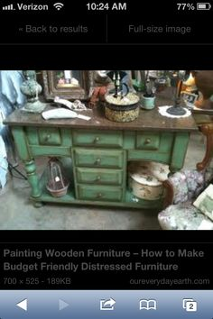 Distressed green furniture piece.
