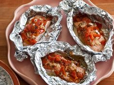 Giada's Salmon Baked in Foil : Baking the salmon in foil allows it to fully soak up the lemon juice and flavor of the herbs without the need for added fats.